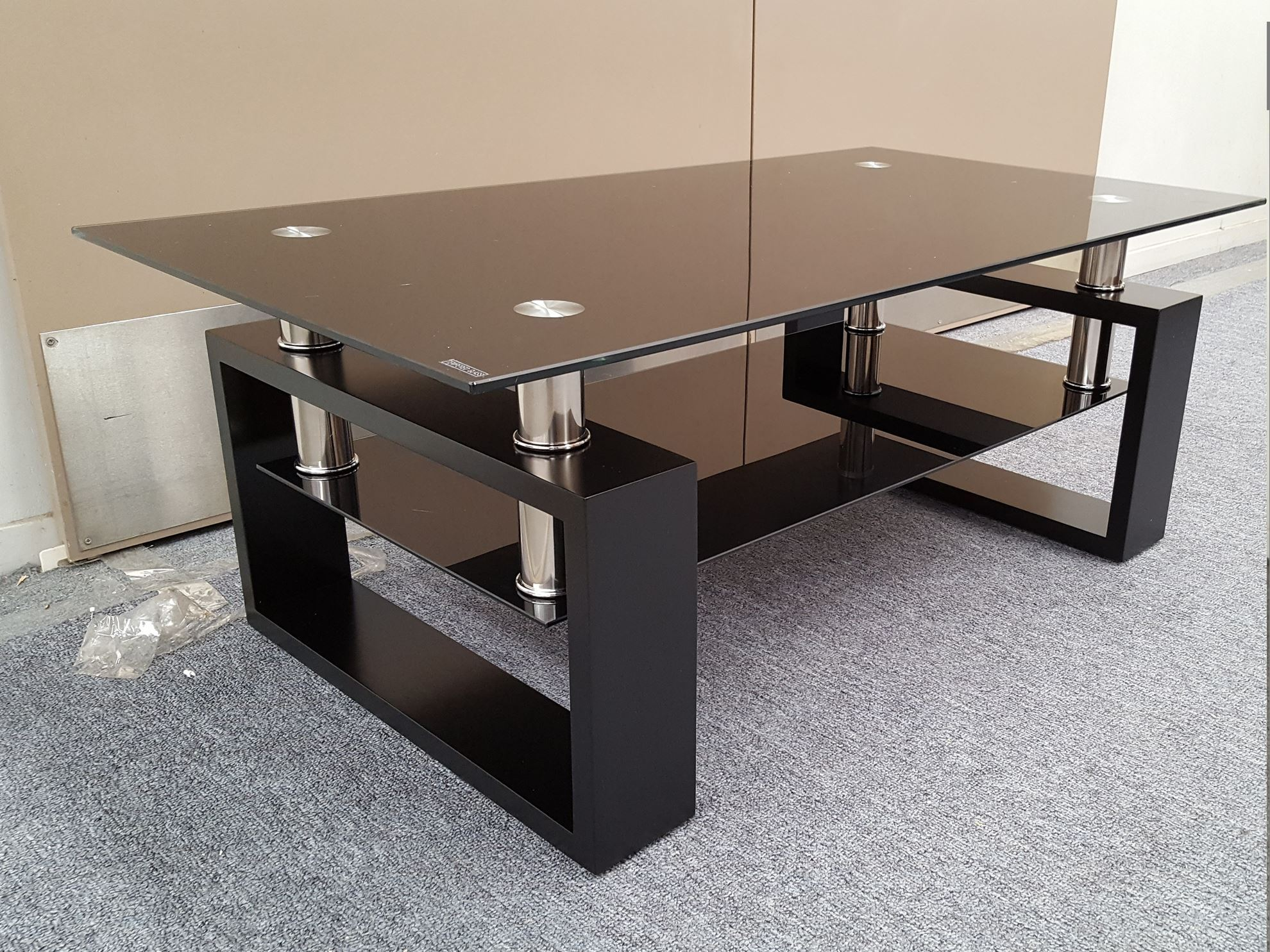 Furniture place kyla glass coffee table with black for Tempered glass coffee table